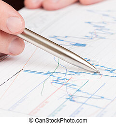 Businessman indicating with pen on diagram of financial report - 1 to 1 ratio