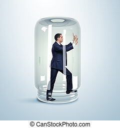 Businessman inside glass jar - Businessman trapped inside a...