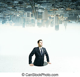 Businessman inside hole looking up
