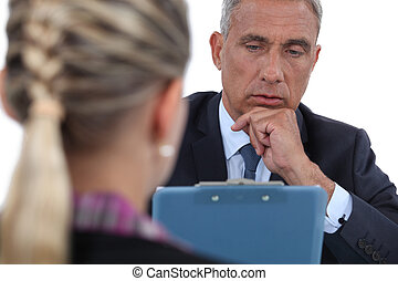 Businessman interviewing a woman
