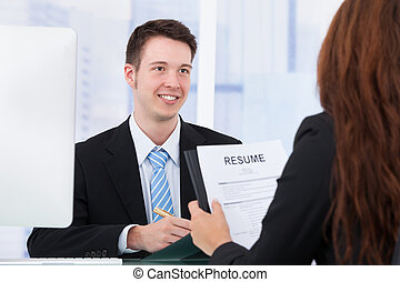 Businessman Interviewing Female Candidate In Office