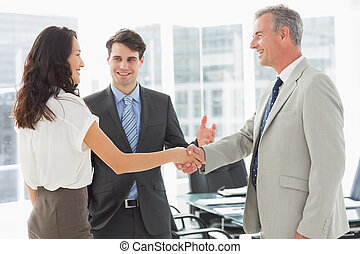 Businessman introducing colleagues in the office