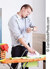 Businessman ironing