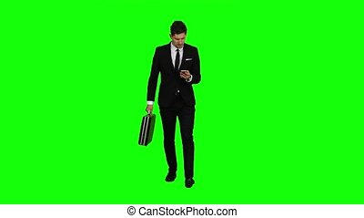 Businessman is a diplomat, a telephone rings to him and he talks. Green screen
