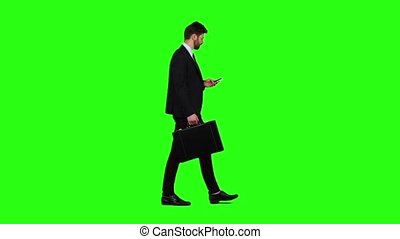 Businessman is a diplomat, a telephone rings to him and he talks. Green screen. Slow motion
