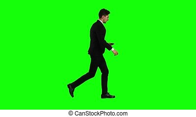 Businessman is a telephone rings to him and he talks. Green screen