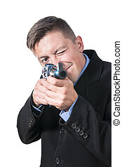 Businessman is aiming with a gun