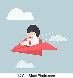 Businessman is flying on paper airplane and looking forward