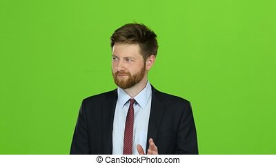 Businessman is going to a meeting and waving greetings. Green screen