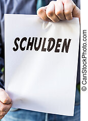 Businessman is holding a paper with german word