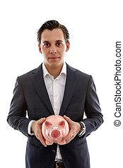 Businessman is holding piggy bank