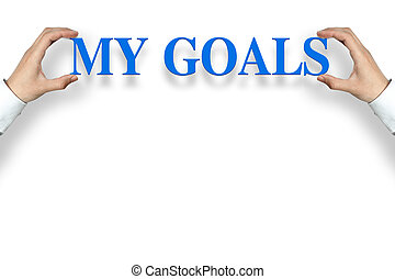 Businessman is holding the My Goals text against the white background with copy space.