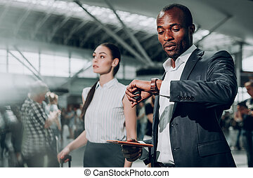 Businessman is looking at his wrist watch