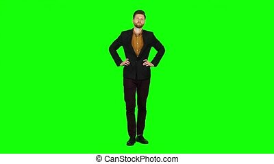 Businessman is nervous and worried, he is upset. Green screen