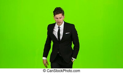 Businessman is ringing the phone, he is late and starts running. Green screen