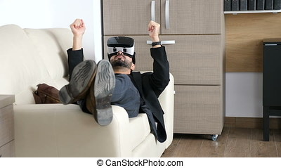 Businessman is taking a break in his office using the VR headset technology