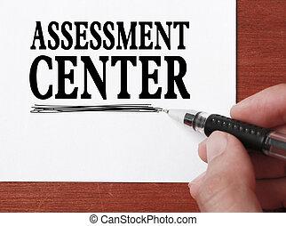 Assessment center - Businessman is writing Assessment center...