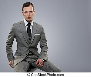 Businessman isolated on grey background.