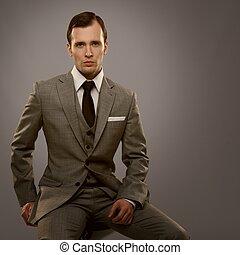 Businessman isolated on grey background