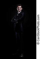 businessman isolated over black background.