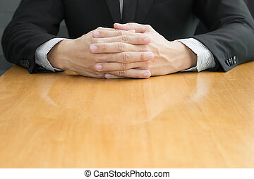 Businessman joining hands on wood table