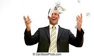 Businessman joyfully throwing his m