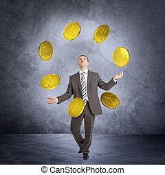 Businessman juggling big coins
