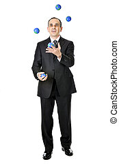 Businessman juggling - Business man in suit juggling planet...