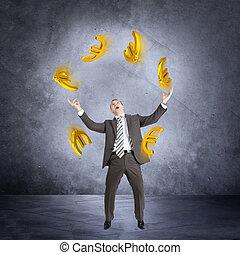 Businessman juggling euro sign