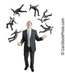 Businessman juggling little people