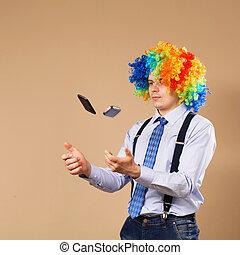 Businessman juggling mobile phones