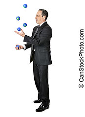 Businessman juggling - Business man in suit juggling planet...