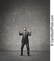 Businessman juggling