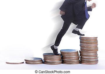 Businessman jump up over coin money graph