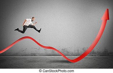 Businessman jump up toward the economic growth