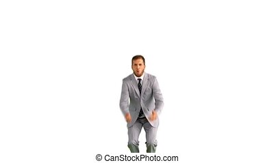 Businessman jumping and doing the splits in slow motion on...