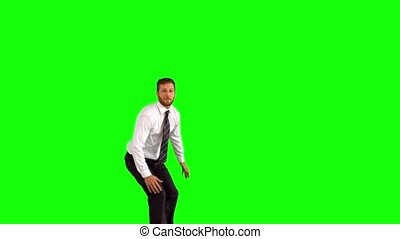 Businessman jumping and grabbing legs