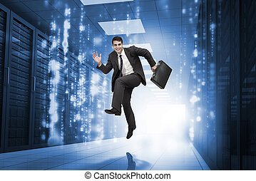 Businessman jumping in a corridor