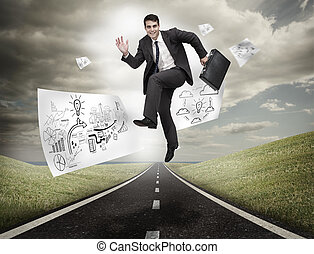 Businessman jumping on a road with