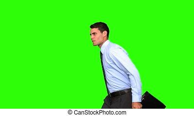 Businessman jumping on green screen