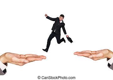 Businessman jumping on hands