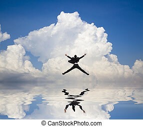 businessman jumping on the water and Reflection with cloud background