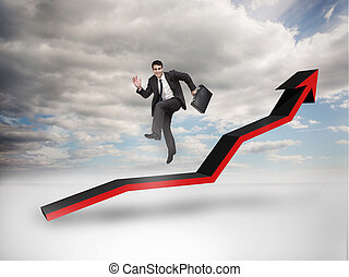 Businessman jumping over a red arro