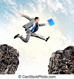 Businessman jumping over gap - Image of young businessman ...