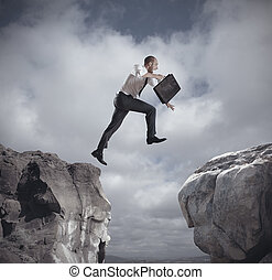 Businessman jumping over the mountains. concept of ambition...