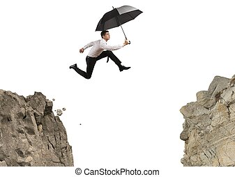 Businessman jumping over the mountains