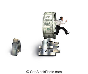 Businessman jumping through circle on stack of money symbols...