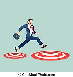 Businessman jumping to big target