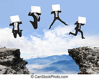 businessman jumping with billboard on the mountain