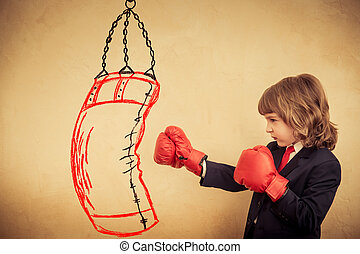 Businessman kid in red boxing gloves